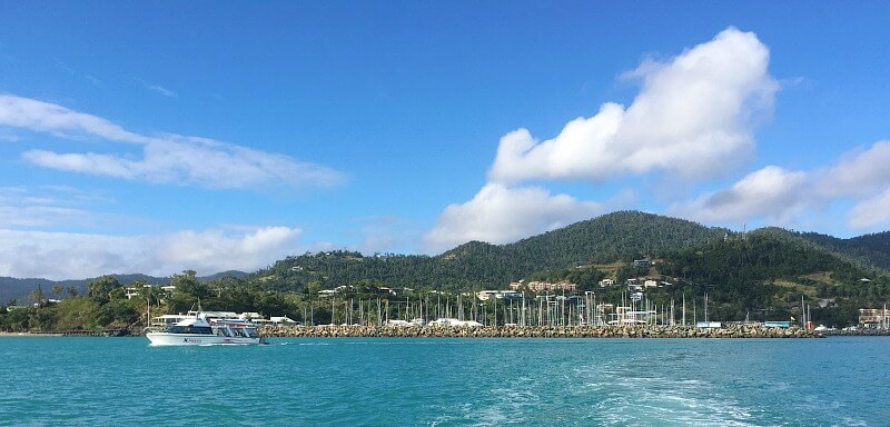 Blue Skies and Water with Airlie Beach in the background