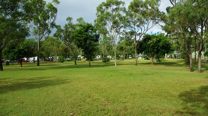 Green Grass and stormy skies at Hydeaway Bay Caravan Park