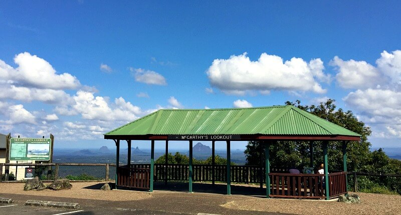 McCarthy's Lookout Sunshine Coast Hinterland is a large shelter with a green roof and fantastic views of the glass house mountains