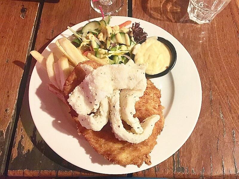 Banjos Airlie Beach Calamari topped Schnitzel Chips and Salad