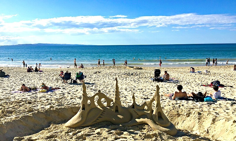 Sand Sculpture on Noosa Main Beach with the Ocean and Fraser Island in the background