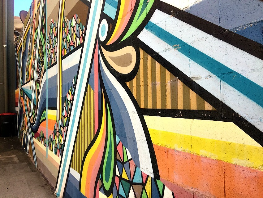 Colourful geometic landscape inspired mural by Beastman Street Artist