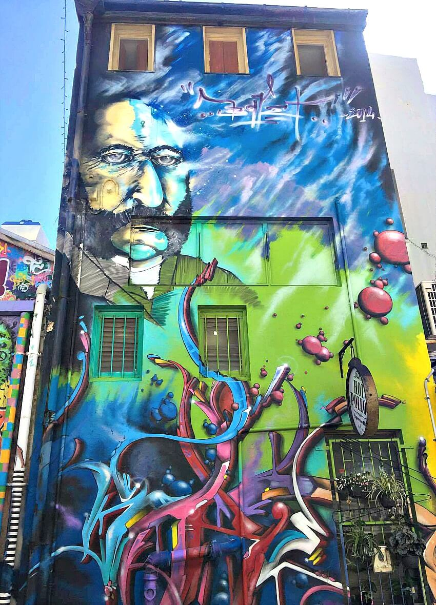 An untitled Street Mural by Kennie Deaner showing the face of Captain William Howard Smith