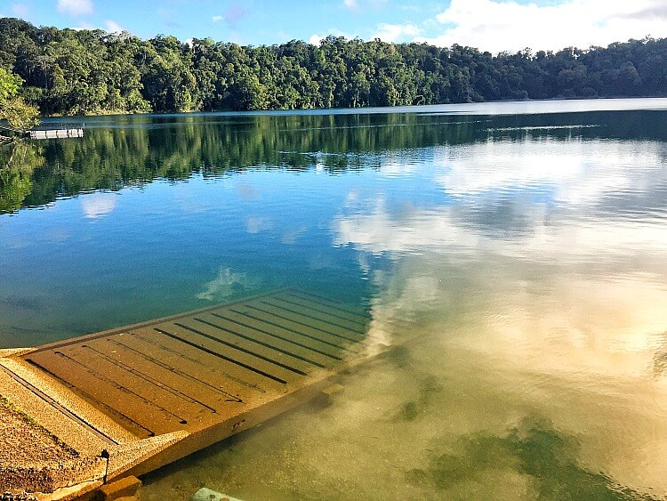 Lake Eacham is an accessible swimming spot on the Atherton Tableland