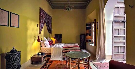 Charming yellow toned El Fenn Room Airbnb Marrakech