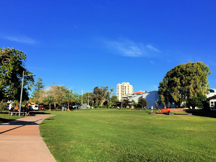 Green park for picnics with pathways and table tennis at Coolum Beach