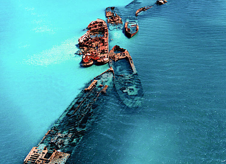 Overhead shot of Tangalooma Wreck on Moreton Island showing two toned blue water