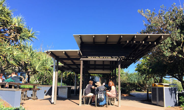 Undercover Picnic Tables under blue skies at Tickle Park Coolum Beach