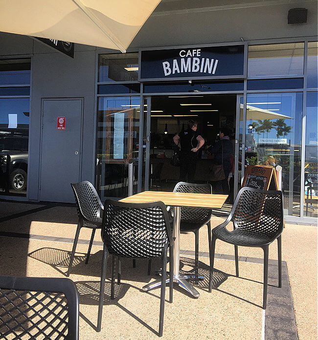 Outdoor table and chairs at Bambini Domain Cafe a dog friendly cafe Townsville
