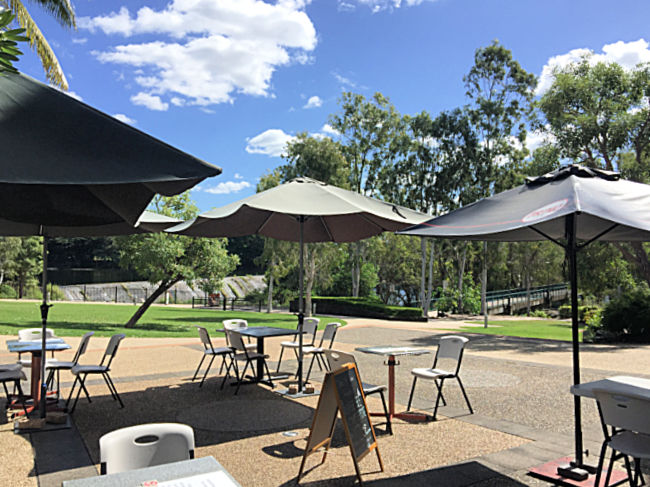 Outdoor tables chairs and umbrellas at Mocha Mecca Douglas Townsville